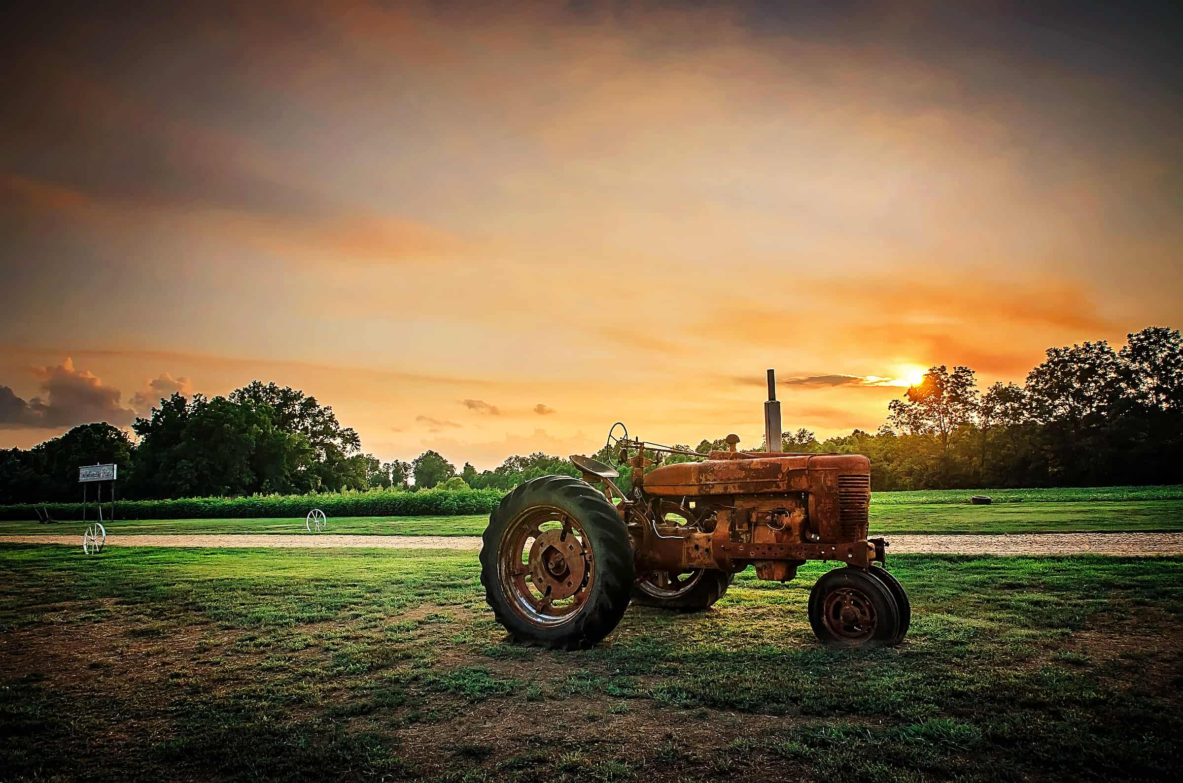 Sunset and antique tractor at Tallahatchee Flats in Greenwood Mississippi