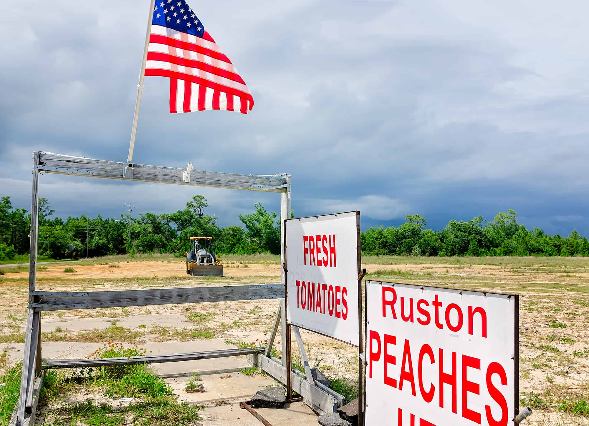 American flag with Ruston peaches sign at a roadside fruit stand in Pass Christian Mississippi