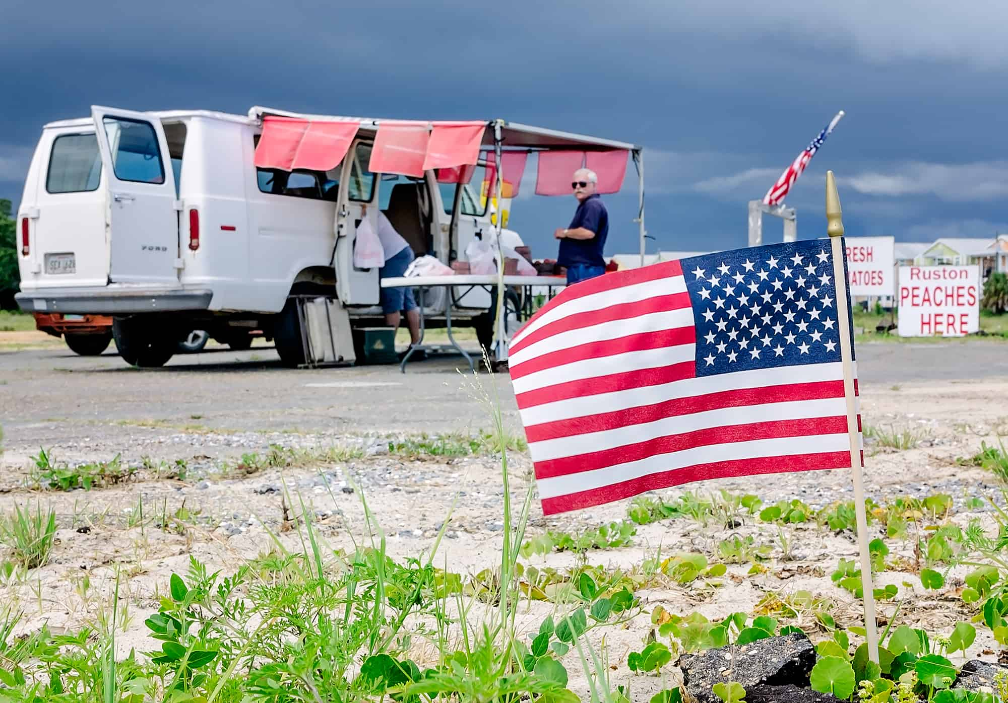 American flags fly at roadside fruit stand in Pass Christian Mississippi