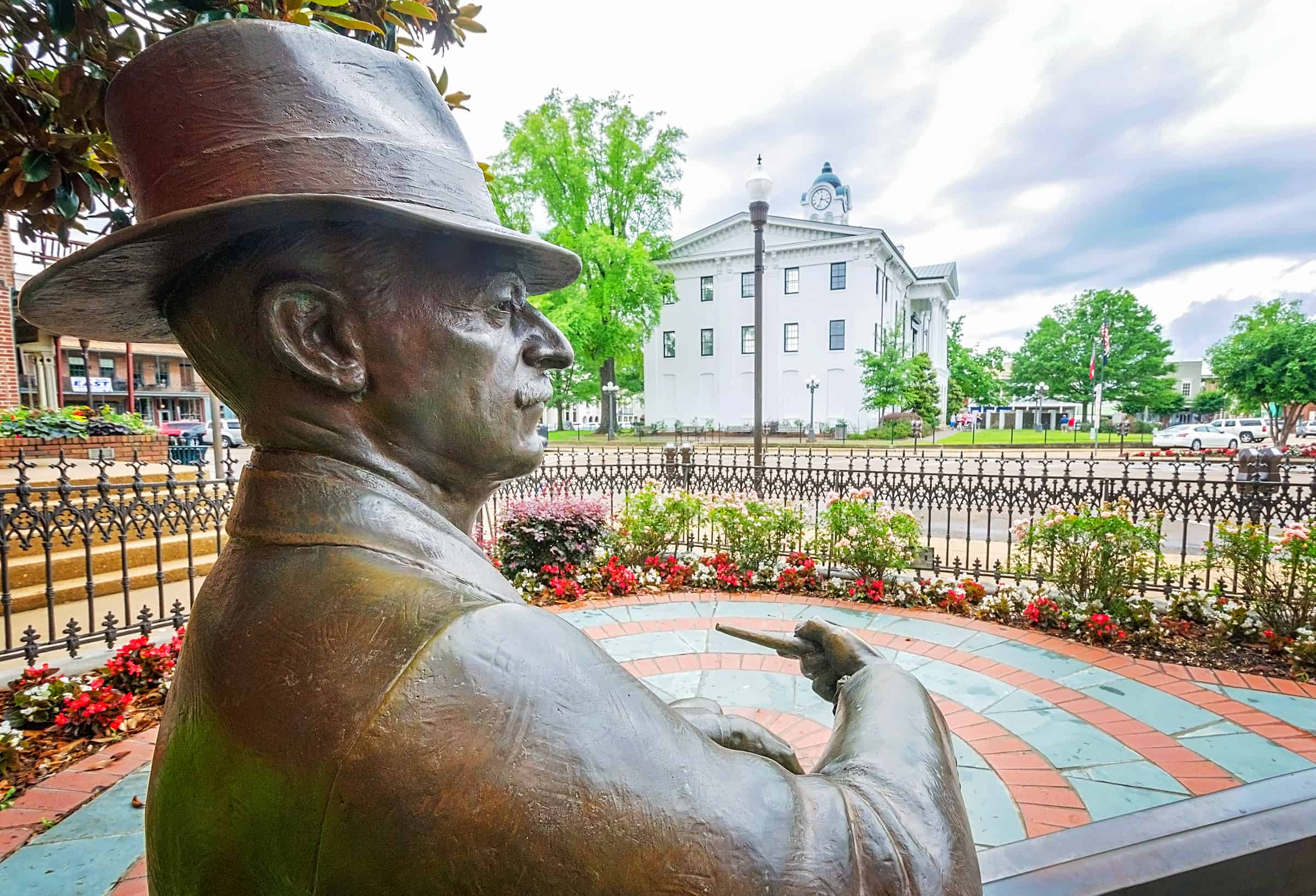 A bronze statue of William Faulkner looks out over Courthouse Square in Oxford Mississippi